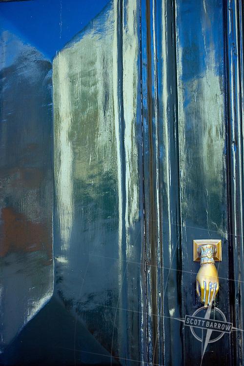 Door with a hand door knocker, Hydra, Greece.