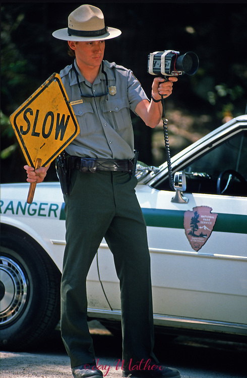 Yosemite National Park Ranger John Christansen monitors vehicles speed entering Yosemite National Park at the Arch Rock entrance.  Memorial Day weekend, May 1989.