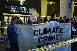 London, UK. 7 October, 2019. Climate activists from Fossil Free London and Reclaim the Power protest outside the Intercontinental Hotel during the Oil and Money conference.