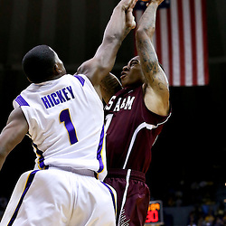Jan 23, 2013; Baton Rouge, LA, USA; Texas A&M Aggies guard J'Mychal Reese (11) shoots over LSU Tigers guard Anthony Hickey (1) the first half of a game at the Pete Maravich Assembly Center. Mandatory Credit: Derick E. Hingle-USA TODAY Sports