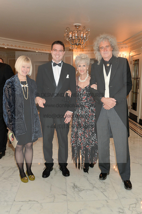 Left to right, SAMANTHA HOE-RICHARDSON, JIMMY MAY, ANITA DOBSON and BRIAN MAY at the David Shepherd Wildlife Foundation 30th anniversary Wildlife Ball at The Dorchester, Park Lane, London on 10th October 2014.