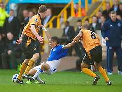 WOLVERHAMPTON, ENGLAND - Saturday, March 27, 2010: Everton's Steven Pienaar is pulled down by Wolverhampton Wanderers' Karl Henry during the Premiership match at Molineux. (Photo by David Rawcliffe/Propaganda)