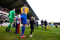 Krystian Pearce of Mansfield Town leads his side out at The One Call Stadium - Mandatory by-line: Robbie Stephenson/JMP - 12/05/2019 - FOOTBALL - One Call Stadium - Mansfield, England - Mansfield Town v Newport County - Sky Bet League Two Play-Off Semi-Final 2nd Leg