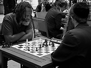 Multi cultural chess players at Bryant Park in New York City