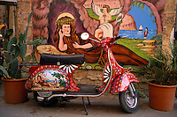 Vespa scooter paint by Franco Bertolino. Workshop Franco Bertolino, artist painter of traditional sicilian cart. Palerme (palermo). Sicily. Italy. MR available