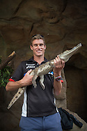 Brad Kahlefeldt (AUS) handles some of the tropical North Queensland wildlife after official press conference of the 2013 Ironman Cairns Triathlon Festival. Cairns Wildlife Dome, Cairns, Queensland, Australia. 06/06/2013. Photo By Lucas Wroe