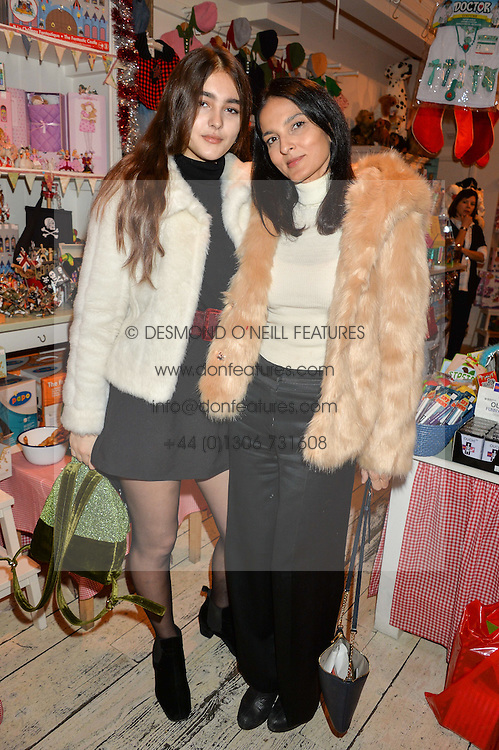 Left to right, MADDIE MILLS and YASMIN MILLS at a promotional party for the A Girl For All Time doll held at HoneyJam, 2 Blenheim Crescent, London on 5th December 2015.