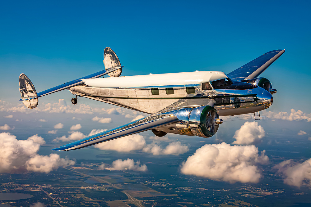 A Lockheed 12A Electra Junior, photographed over the skies of Lakeland, Florida.<br /> <br /> Created by aviation photographer John Slemp of Aerographs Aviation Photography. Clients include Goodyear Aviation Tires, Phillips 66 Aviation Fuels, Smithsonian Air & Space magazine, and The Lindbergh Foundation.  Specialising in high end commercial aviation photography and the supply of aviation stock photography for advertising, corporate, and editorial use.
