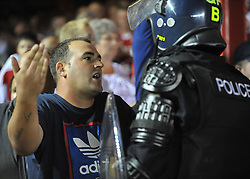 Bristol City fan gets confronted by police after trying to get escape into the rovers end.  - Photo mandatory by-line: Alex James/JMP - Tel: Mobile: 07966 386802 04/09/2013 - SPORT - FOOTBALL -  Ashton Gate - Bristol - Bristol City V Bristol Rovers - Johnstone Paint Trophy - First Round - Bristol Derby