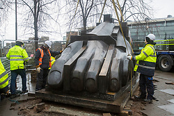 The largest of the three sculptures, The Foot, that makes up The Manuscript of Monte Cassino by Eduardo Paolozzi has been removed from its site on Edinburgh's Picardy Place to allow works on the new St James quarter.<br /> <br /> The work was commissioned by entrepreneur, Sir Tom Farmer and remembers the bombing during WW2 of the Monte Cassino monastery - close to the artists family home.<br /> <br /> Pictured:  The foot is lifted from its position that it has been in since 1991