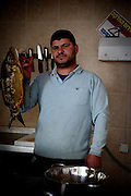 Yusri is a local to the newly built settlements of Har Homa. He is originally from Silwan, another settlements in the West Bank. He works in a fish shop and has been operating it for 2 months. Image © Angelos Giotopoulos/Falcon Photo Agency
