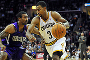Oct. 30, 2010; Cleveland, OH, USA; Cleveland Cavaliers point guard Ramon Sessions (3) drives around Sacramento Kings shooting guard Luther Head (9) during the fourth quarter at Quicken Loans Arena. The Kings beat the Cavaliers 107-104. Mandatory Credit: Jason Miller-US PRESSWIRE