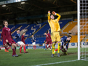 10th November 2017, McDiarmid Park, Perth, Scotland, UEFA Under-21 European Championships Qualifier, Scotland versus Latvia; Dejection for Latvia goalkeeper Kristaps Zommers Scotland's as Ryan Hardie retrieves the ball after scoring an injury time equaliser for 1-1 from the penalty spot