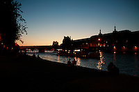 seine, louvre and couples at dusk