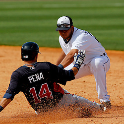 Feb 27, 2013; Lakeland, FL, USA; Detroit Tigers shortstop Jhonny Peralta (27) tags out Atlanta Braves shortstop Ramiro Pena (14) at second base during the top of the fourth inning of a spring training game at Joker Marchant Stadium. Mandatory Credit: Derick E. Hingle-USA TODAY Sports