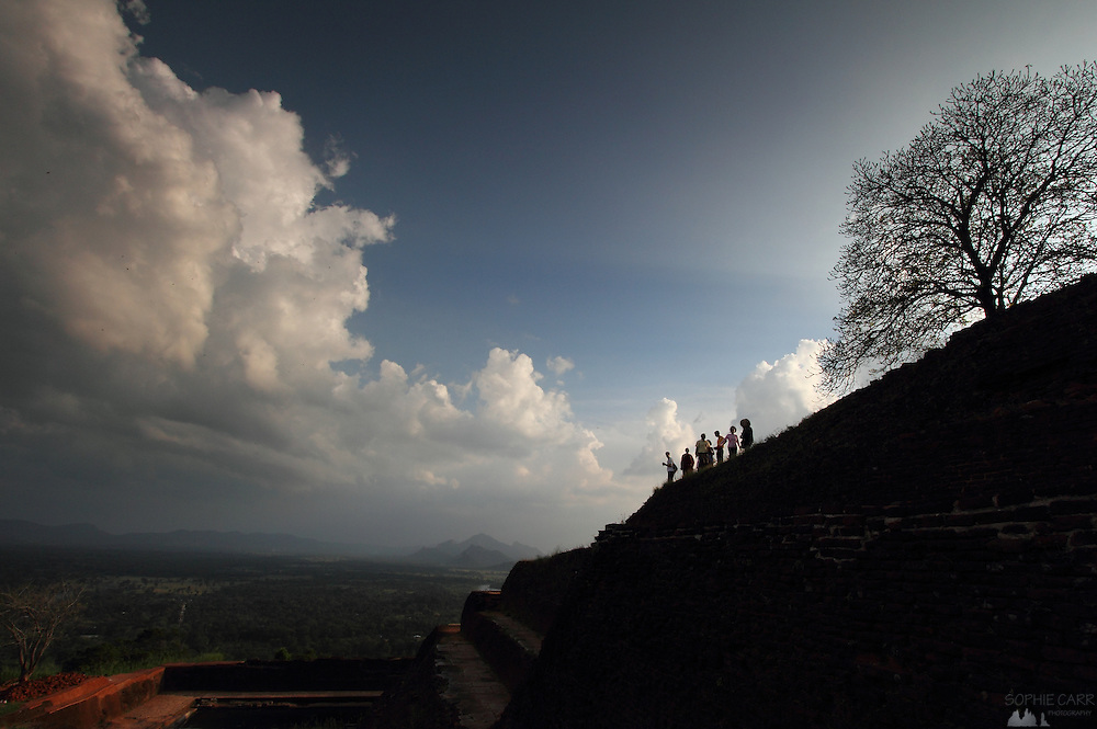 Tourists enjoy the view from the top of Sigiriya, Sri Lanka, just before sunset