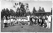 A group of football players gather on Calix Grounds in Kibera. (1961)