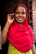 A garment worker taking part in LaborVoice's SmartLine, which allows workers to share feedback on their safety and working conditions, quickly and anonymously via their mobile phone.<br /> <br /> The SmartLine provides brands and suppliers real-time visibility into factory conditions, enabling them to identify and solve problems before they become urgent.