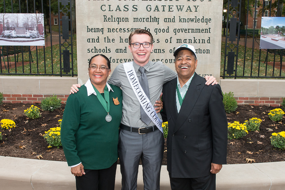Ohio University President, Roderick McDavis, and Ohio University First Lady, Deborah McDavis, pose with Brendon Embry, a member of Ohio University's Homecoming Court, at the College Gateway on October 8, 2016.