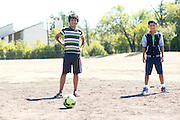 Roshan Biswa (13) and Roshan Diyali (13) play soccer across from their homes in the Ivy Apartments where Thomas E. Duncan, the first confirmed Ebola virus patient in the United States, was staying with family in Dallas, Texas on October 4, 2014. Duncan is now being treated at Texas Health Presbyterian Hospital Dallas while members of his family have been isolated in the apartment. (Cooper Neill for The New York Times)