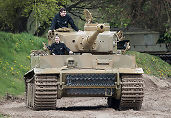 © Licensed to London News Pictures. 28/04/2018. Dorset, UK.  Competition winners Thijs Lepstra (top) and Deidre Crouch enjoy a ride in German WWII battle tank legend 'Tiger 131' during a display at Bovington Tank Museum on the 75th anniversary of it's capture. Tiger 131, the only running Tiger I in the world,  was the first example of the fearsome new German fighting machine to be captured by the allies when it was caught during fierce fighting in the Tunisian desert in 1943. Photo credit: Peter Macdiarmid/LNP