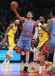 February 12, 2019 - Atlanta, GA, USA - Atlanta Hawks guard Trae Young drives past Los Angeles Lakers forward LeBron James on his way to the basket for two points during the first half on Tuesday, Feb. 12, 2019 in Atlanta, Ga. (Credit Image: © Curtis Compton/Atlanta Journal-Constitution/TNS via ZUMA Wire)
