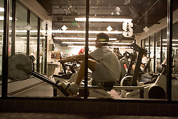 Stanford after dark. Stanford Freshman Armon Shaei on rowing machine at Stanford