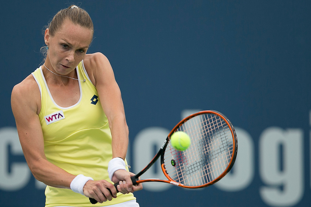August 22, 2014, New Haven, CT:<br /> Magdalena Rybarikova hits a backhand during the semi-final match against Camila Giorgi on day eight of the 2014 Connecticut Open at the Yale University Tennis Center in New Haven, Connecticut Friday, August 22, 2014.<br /> (Photo by Billie Weiss/Connecticut Open)