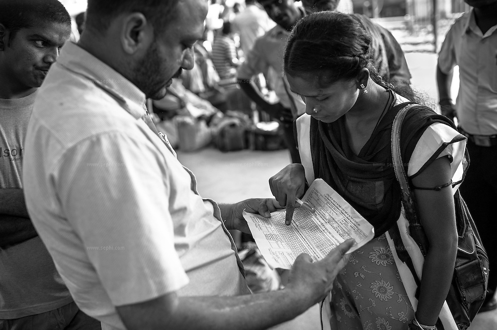 A supervisor examines the tally sheet for vaccination of children at transit points filled by a vaccinator at Patna railway station.  Transit teams are deployed at strategic locations including international borders to reach mobile and migrant populaitons.