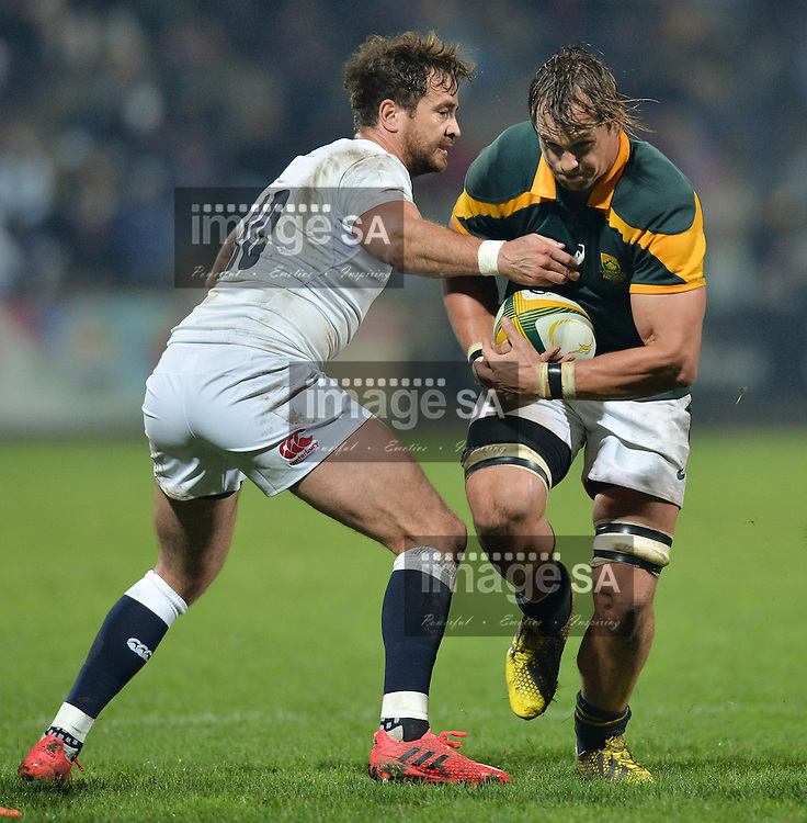 GEORGE, SOUTH AFRICA - JUNE 17: Arno Botha of South Africa runs through the tackle of Danny Cipriani of England during the match between South Africa 'A' and England Saxons at Outeniqua Park on June 17 2016 in George, South Africa. (Photo by Roger Sedres/Gallo Images)