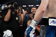 Oscar De La Hoya cheers as Canelo Alvarez enters the ring at AT&T Stadium in Arlington, Texas on September 17, 2016.  (Cooper Neill for ESPN)