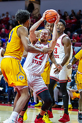 NORMAL, IL - December 07: Matt Chastain struggles inside to get a shot up over James Baker during a college basketball game between the ISU Redbirds and the Morehead State Eagles on December 07 2019 at Redbird Arena in Normal, IL. (Photo by Alan Look)