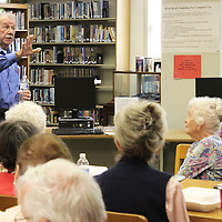 Former Aberdeen Police Chief Brent Coleman explains stories from his law enforcement years to the crowd at last week's Aberdeen Booklunch.