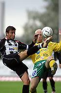 12.08.2004, Veritas Stadion, Turku, Finland..Veikkausliiga 2004 / Finnish League 2004.FC TPS Turku v KooTeePee.Marco Casagrande (TPS) v Lassi Lehtonen (KooTeePee).©Juha Tamminen.....ARK:k