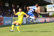 AFC Wimbledon defender Jon Meades (3) is beaten by Reading FC defender Jordan Obita during the Pre-Season Friendly match between AFC Wimbledon and Reading at the Cherry Red Records Stadium, Kingston, England on 23 July 2016. Photo by Stuart Butcher.