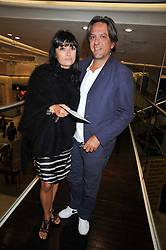 Giorgio Locatelli and his wife Plaxy at the launch of Tom Parker Bowles's new book 'Full English' held in the Gallery Restaurant, Selfridges, Oxford Street, London on 9th September 2009.