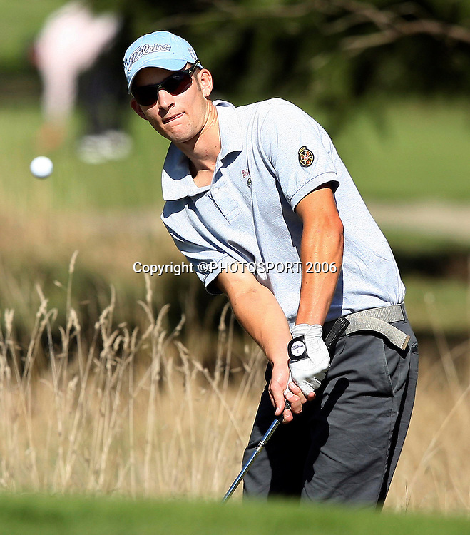 James Gill from Hamilton eyes his shot onto the green during the 1st days play at the 2006 New Zealand Amateur Stroke Play Championship at Coringa Country Club near Christchurch, New Zealand. 3 April 2006. Photo: PHOTOSPORT
