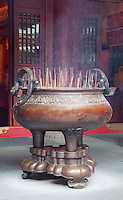 An enormous, ornate incense burner in a Buddhist temple in Singapore, Asia.