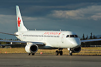 Air Canada Embraer 190 taxies in the setting sun in Whitehorse, Yukon