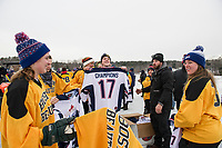 The Boston Beauties receive their first place championship jerseys from Scott Crowder after Sunday's final rounds of the New England Pond Hockey Classic.  (Karen Bobotas/for the Laconia Daily Sun)