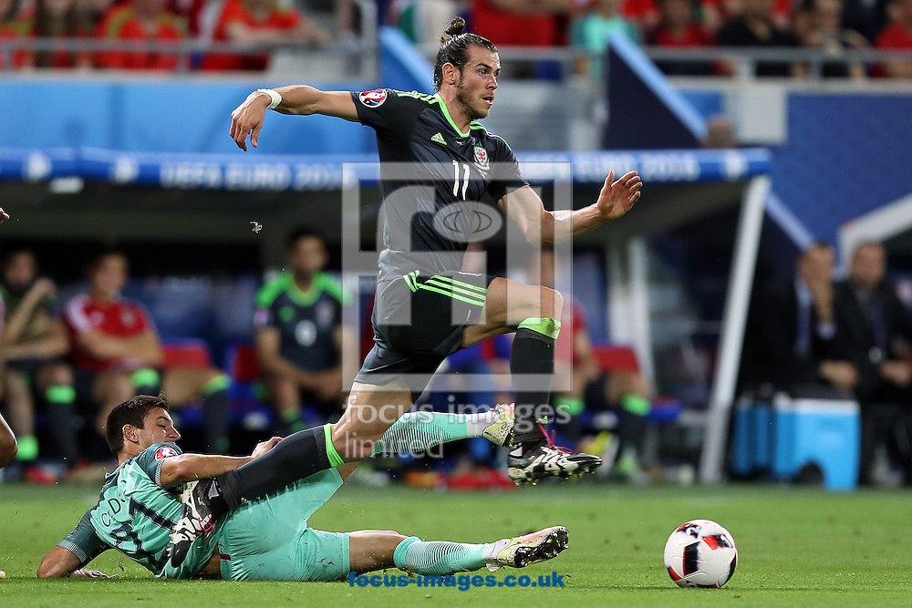 Cedric of Portugal and Gareth Bale of Wales in action during the UEFA Euro 2016 semi-final match at Stade de Lyons, Lyons<br /> Picture by Paul Chesterton/Focus Images Ltd +44 7904 640267<br /> 06/07/2016