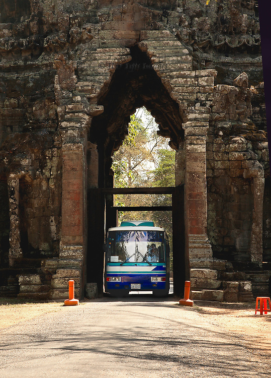 Angkor Thom: North Gate, with a large tourist bus squeezing through, inches to spare on either side.  Ancient and modern things co-existing.