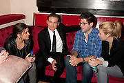 actor Kevin Zegers (center in tie) with guests