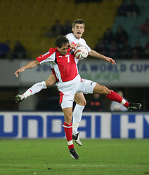 VIENNA, AUSTRIA - WEDNESDAY MARCH 30th 2005: Wales' Sam Ricketts and Austria's Roland Kirchler during the World Cup Qualifying Group Six match at the Ernst Happel Stadium. (Pic by David Rawcliffe/Propaganda)