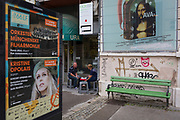 Two people chat outside a cafe in the Slovenian capital, Ljubljana, on 28th June 2018, in Ljubljana, Slovenia.