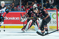 KELOWNA, BC - FEBRUARY 17: Jett Woo #22 of the Calgary Hitmen clears the puck away from the crease during second period against the Kelowna Rockets at Prospera Place on February 17, 2020 in Kelowna, Canada. (Photo by Marissa Baecker/Shoot the Breeze)