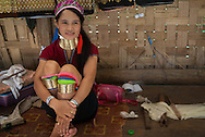 The Kayan, sometimes referred to as the Padaung, are a tribal people who are currently refugees in Thailand in the province of Mae Hong Son. They wear distinctive brass rings on their necks, which give the appearance of elongation. There are two theories as to how the wearing of brass rings originated. One is that a dragon was impregnated by the wind and gave birth to the Kayan people, the other is that it originated as a practical measure to protect ancient peoples from tiger attacks. Whatever the reason, it is considered a mark of beauty.