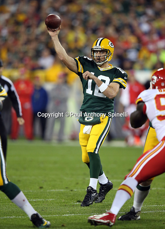 Green Bay Packers quarterback Aaron Rodgers (12) throws a first quarter pass during the 2015 NFL week 3 regular season football game against the Kansas City Chiefs on Monday, Sept. 28, 2015 in Green Bay, Wis. The Packers won the game 38-28. (©Paul Anthony Spinelli)