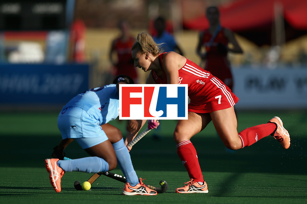 JOHANNESBURG, SOUTH AFRICA - JULY 18: Hannah Martin of England and Nikki Pradhan of India battle for possession during the Quarter Final match between England and India during the FIH Hockey World League - Women's Semi Finals on July 18, 2017 in Johannesburg, South Africa.  (Photo by Jan Kruger/Getty Images for FIH)