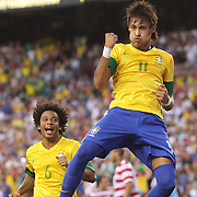 Neymar, Brazil, celebrates after scoring from the penalty spot during the USA V Brazil International friendly soccer match at FedEx Field, Washington DC, USA. 30th May 2012. Photo Tim Clayton